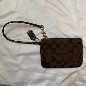 Coach wristlet dark brown